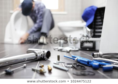 plumber repairing a siphon stock photo © photography33