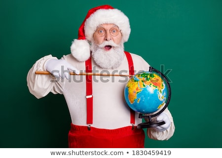Santa pointing out a continent on globe Stock photo © stockyimages