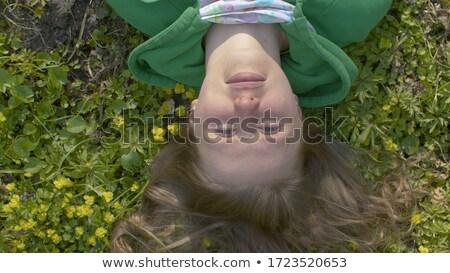 portré · szőke · nő · fektet · mosoly · közelkép - stock fotó © carlodapino