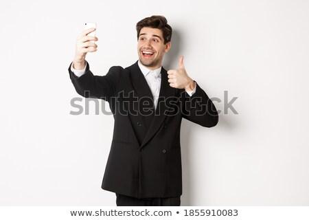 Portrait of a businessman praising against white babckground Stock photo © wavebreak_media