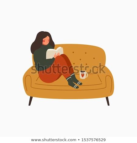 женщину сидят диван кружка кофе Сток-фото © wavebreak_media