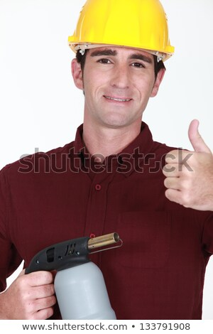 craftsman holding a welding torch and making thumbs up sign Stock photo © photography33