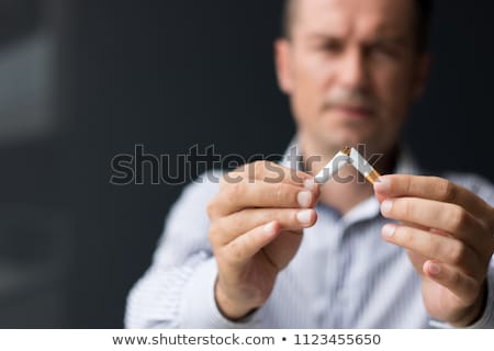 male hands breaking a cigarette in half stock photo © wavebreak_media