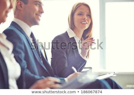 Smiling man asking question in lecture Stock photo © wavebreak_media
