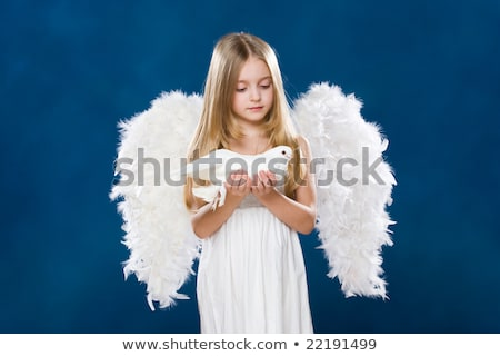 Little girl with pigeons on the arms Stock photo © przemekklos