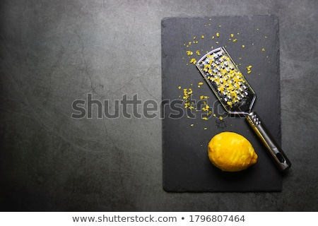 Grated lemon zest with the fruit and grater Stock photo © sarahdoow