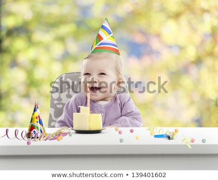 little girl with at her first birthday Stock photo © balasoiu