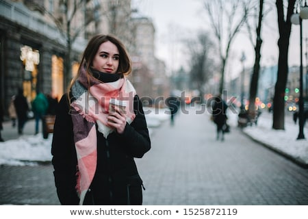 sad woman in muffler stock photo © dolgachov
