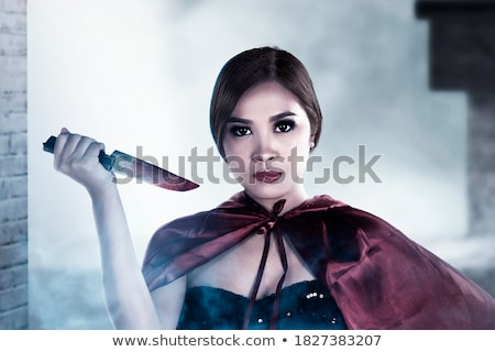 Woman dress for halloween with bloody knife Stock photo © lunamarina