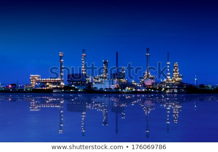 Reflection of petrochemical plant at night Stock photo © shirophoto