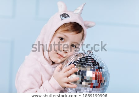 Four smiling girls with a disco ball Stock photo © AndreyPopov