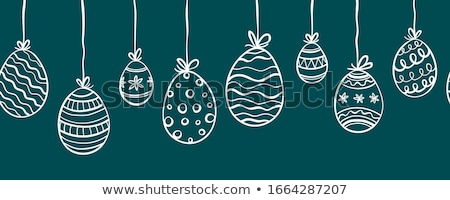 easter eggs hanging on branches stock photo © virgin