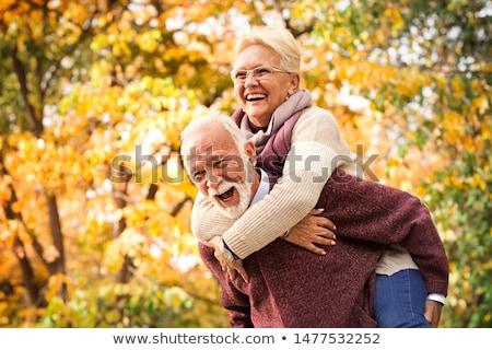 mosolyog · szórakozás · erdő · boldog · fiatal · pér · szép - stock fotó © DNF-Style