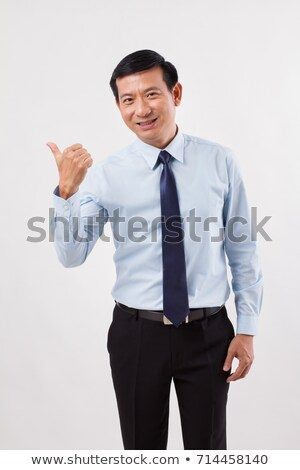 business man points to side and approves stock photo © feedough