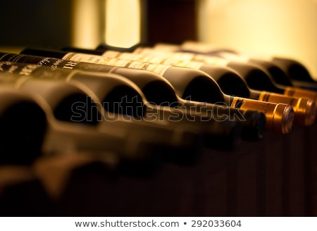 Stock photo: Stored wine bottles.