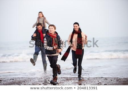 çocuklar · üç · birlikte · oturma · plaj · su - stok fotoğraf © monkey_business
