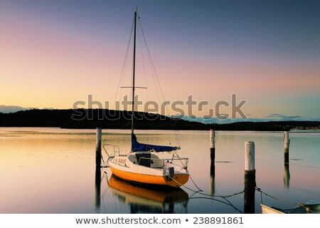 Sunrise at Woy Woy with little boat and moorings Stock photo © lovleah