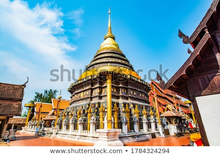 Ancient pagodas at Wat Phra That Lampang Luang temple Stock photo © Yongkiet