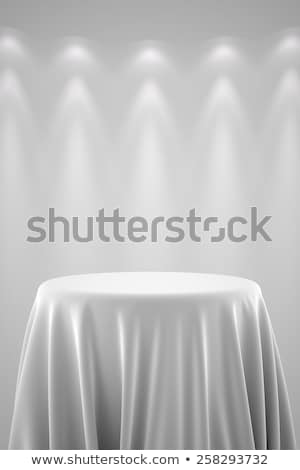 round pedestal with silk cloth and spot lights stock photo © creisinger