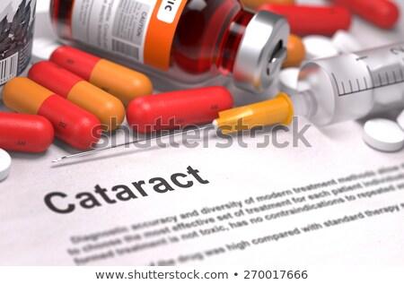 Katarakt tıbbi kırmızı hapları şırınga seçici odak Stok fotoğraf © tashatuvango
