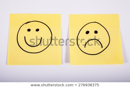Unhappy Face on a Piece of Memo Paper Stock photo © chrisdorney