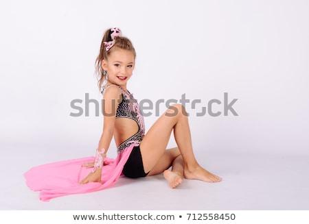 Beautiful girl acrobático belo jovem isolado Foto stock © deandrobot