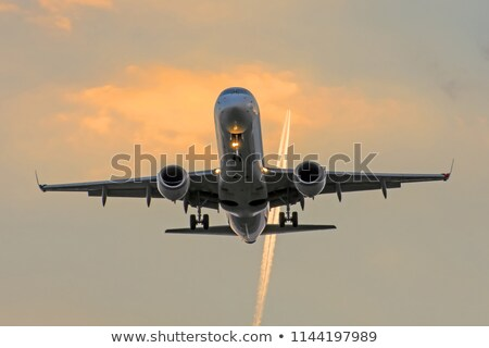 Contrails in the blue sky before sunrise Stock photo © Mps197