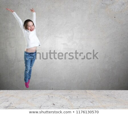 hip hop dance jumping in the air against wall stock photo © stryjek