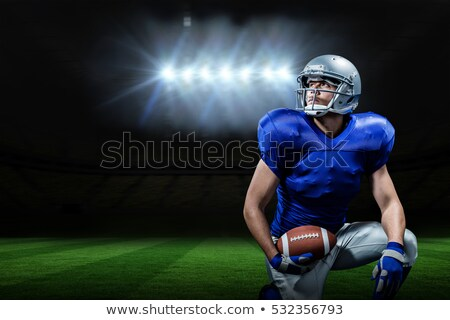 composite image of american footballer looking up stock photo © wavebreak_media