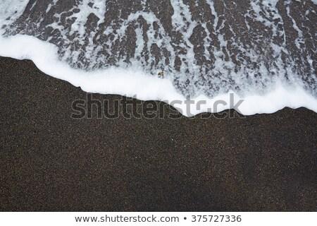 Nero sabbia spiaggia onda schiuma texture Foto d'archivio © lunamarina