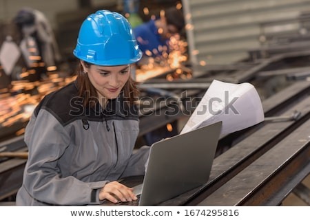 Confident smiling welder. Stock photo © RAStudio