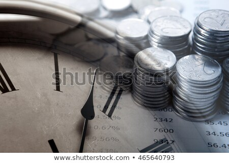 pile of coins with digits and clock face Stock photo © mizar_21984