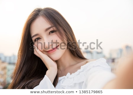 Attractive girl relaxes on roof Stock photo © Aikon
