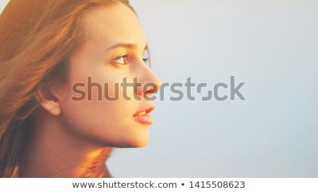 Pretty brunette lady with golden skin Stock photo © konradbak