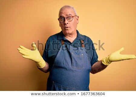 Confused cleaner shrugging shoulders. Stock photo © RAStudio