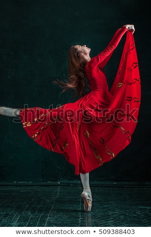 Stock photo: Ballerina posing in pointe shoes at black wooden pavilion