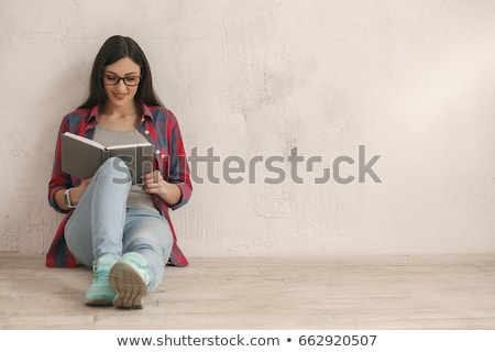 happy young woman reading a novel  Stock photo © feedough