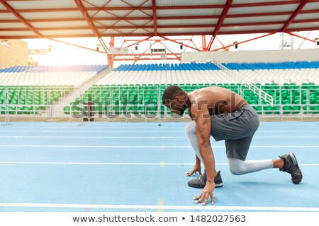 full lenght photo of young african sports man standing with cro stock photo © deandrobot