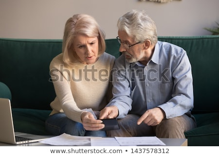 Couple calculating bills Stock photo © IS2