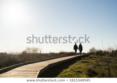 Pár kéz a kézben vidéki út nő férfi vakáció Stock fotó © IS2