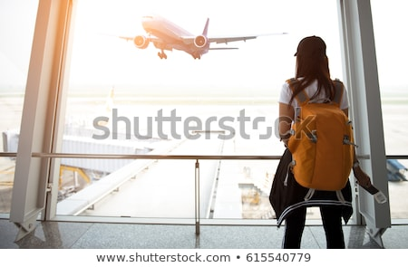 tourist woman with backpack traveling by plane stock photo © dolgachov