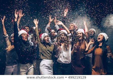 Christmas Party, Man Throwing Hat, Dancing Woman Stock photo © robuart
