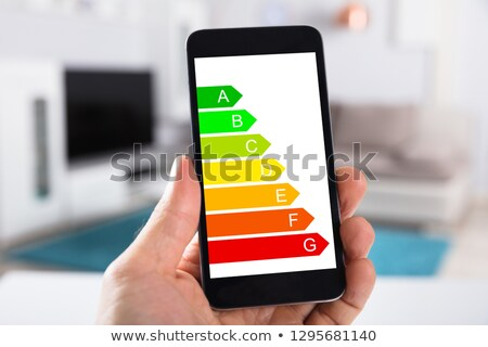 person with cellphone showing energy efficiency chart stock photo © andreypopov