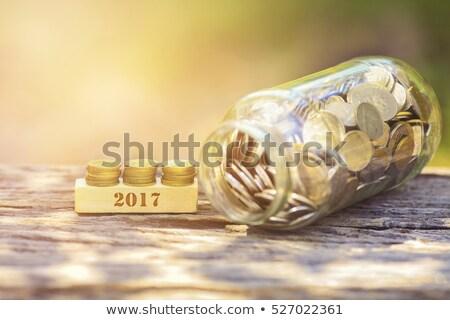 Golden Piggy Banks Dark Table Stock photo © limbi007