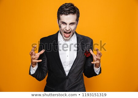Angry psycho man zombie screaming isolated over orange Stock photo © deandrobot