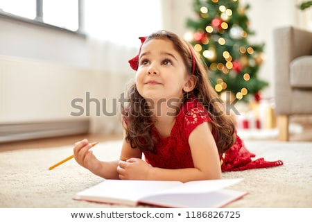 little girl making christmas wish list at home Stock photo © dolgachov