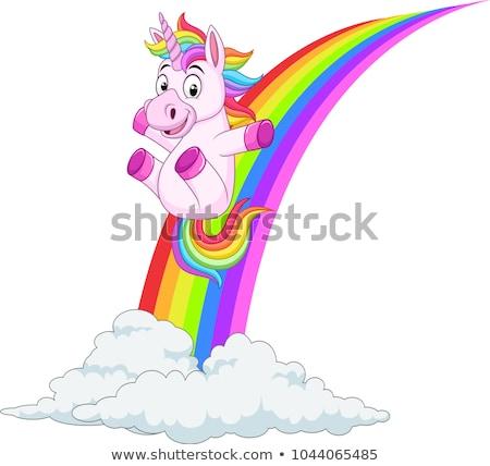A happy unicorn slide on rainbow Stock photo © bluering