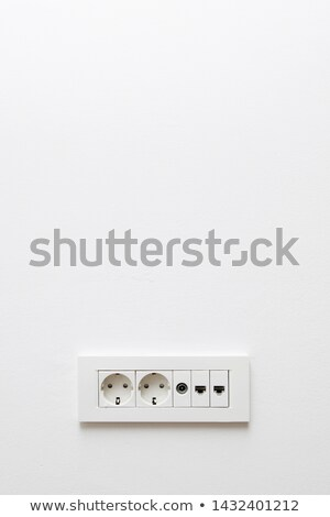 Wall in modern appartment with plugs for internet, network and e Stock photo © boggy