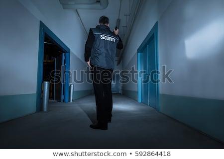 Erkek güvenlik görevlisi ayakta koridor el feneri Stok fotoğraf © AndreyPopov