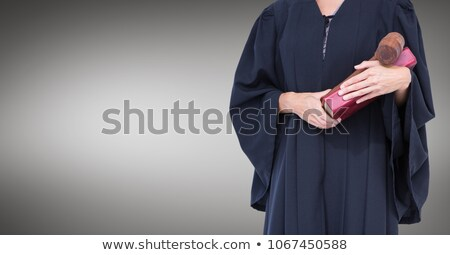Female judge with gavel against grey background Stock photo © wavebreak_media